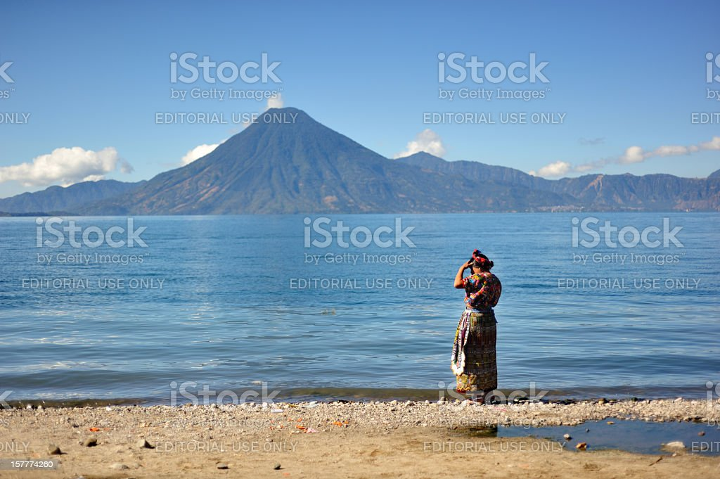 Woman on the shores of Lake Atitlan stock photo