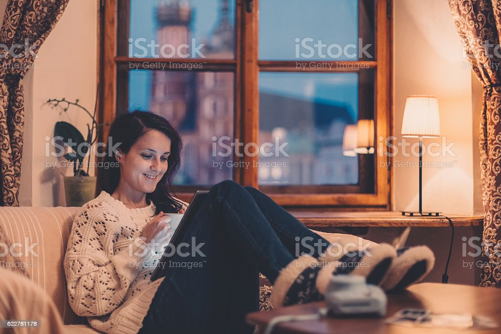 Woman on the sofa watching tv stock photo