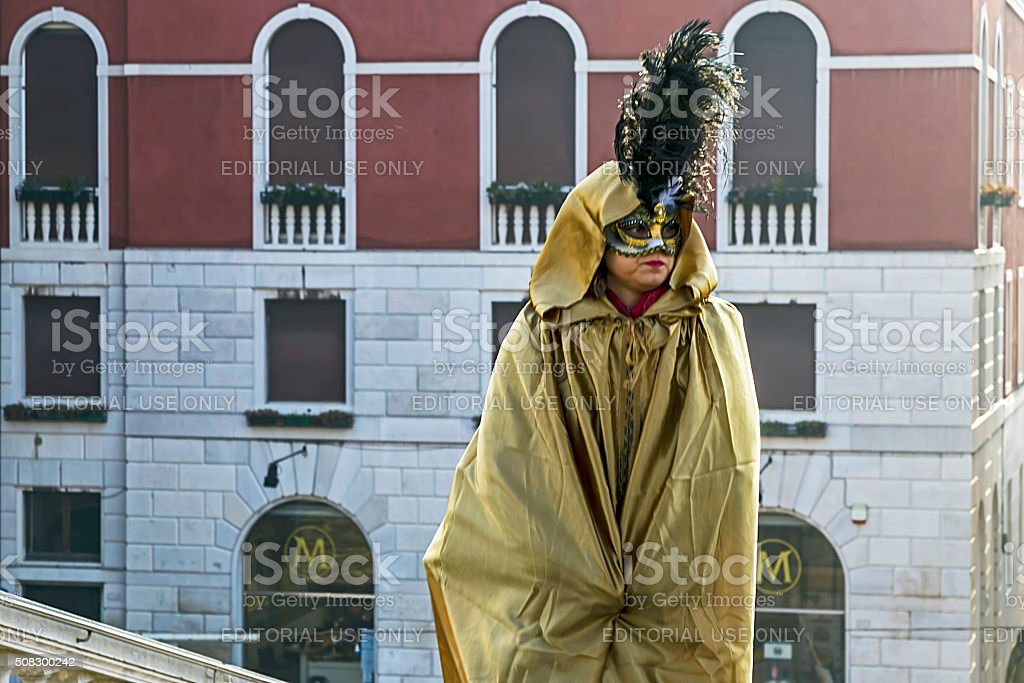 Woman on the street in Venice, dressed in period costumes stock photo