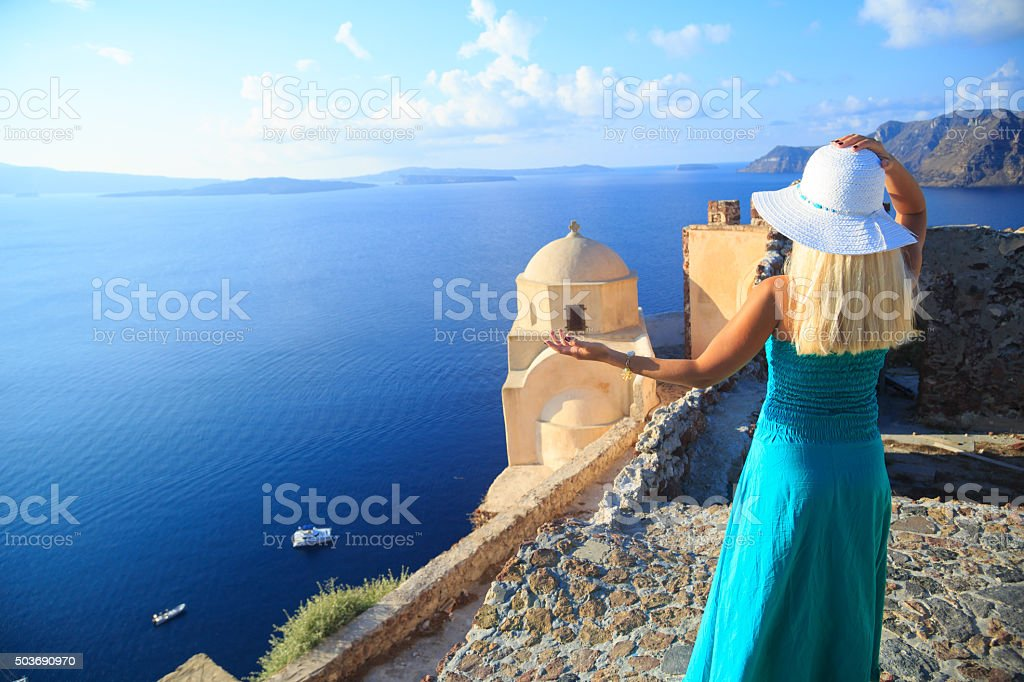 Woman on the streets of Oia, Santorini - copy space stock photo