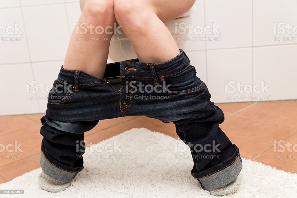 woman on the toilett is suffering about congestion stock photo