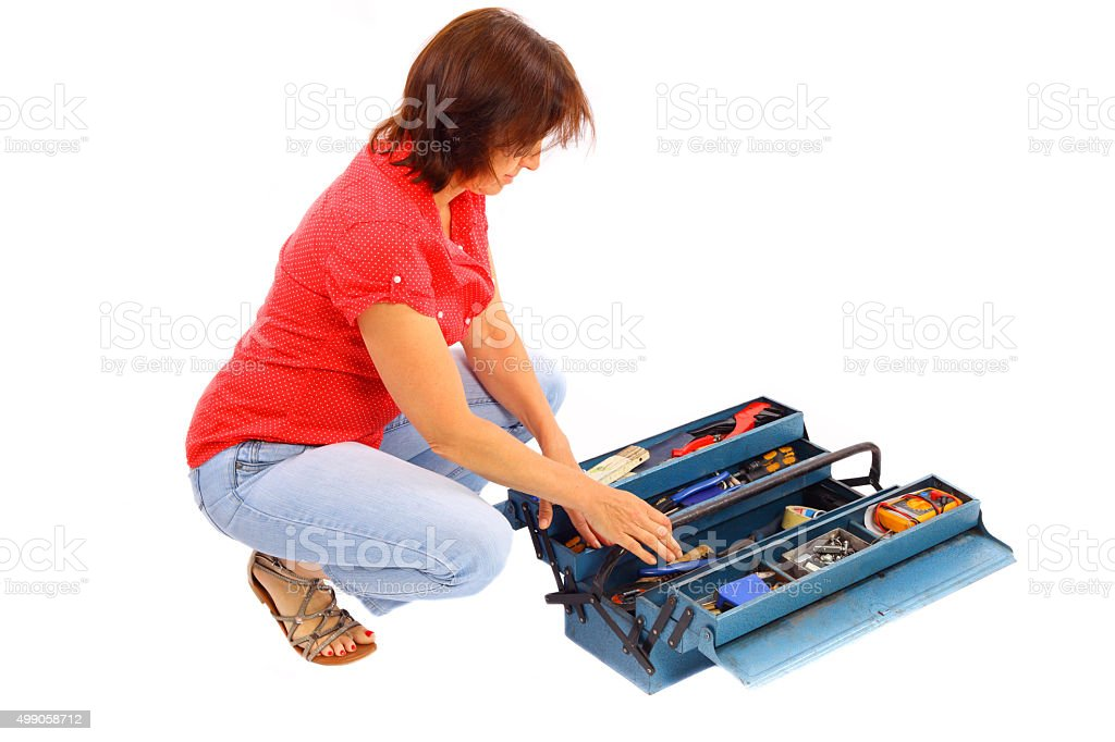 Woman on the tool box-isolated stock photo