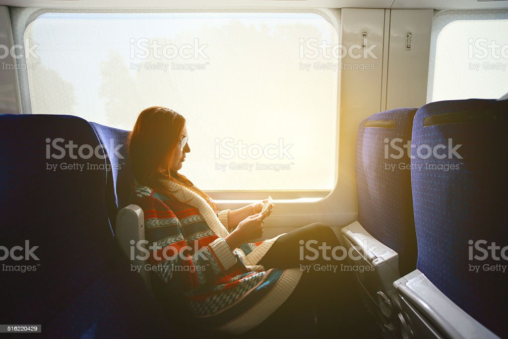 Woman on the train stock photo