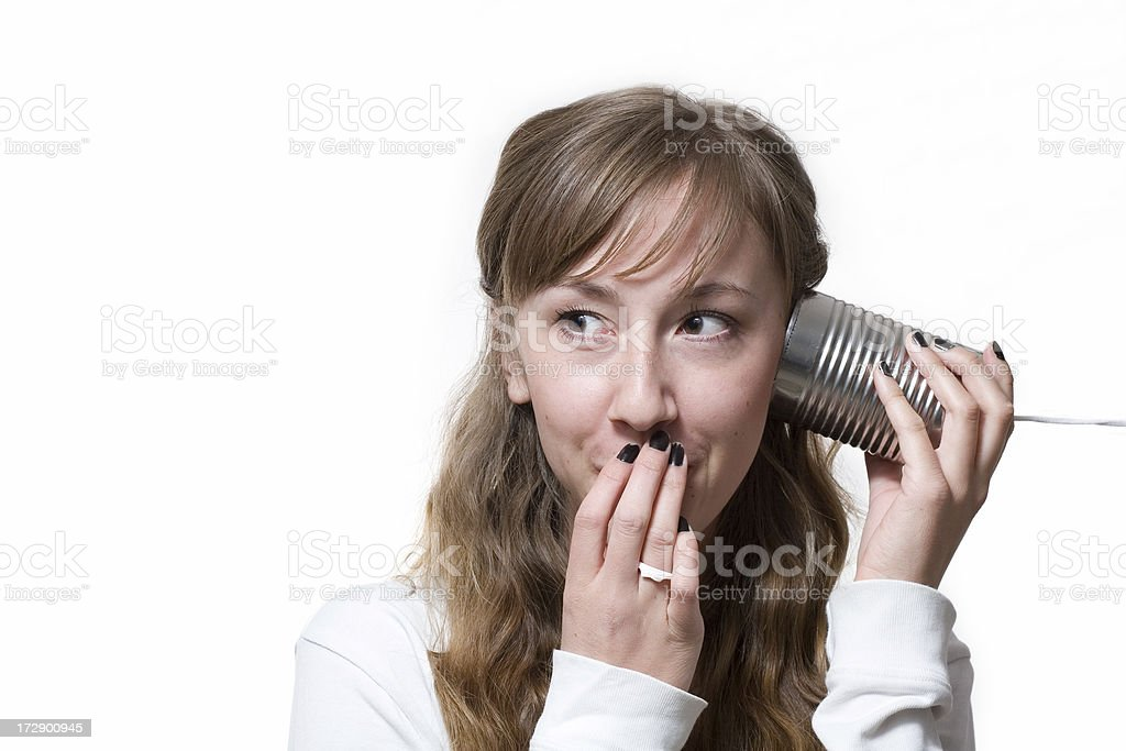 Woman on Tin Can Phone Covering Mouth with Hand royalty-free stock photo