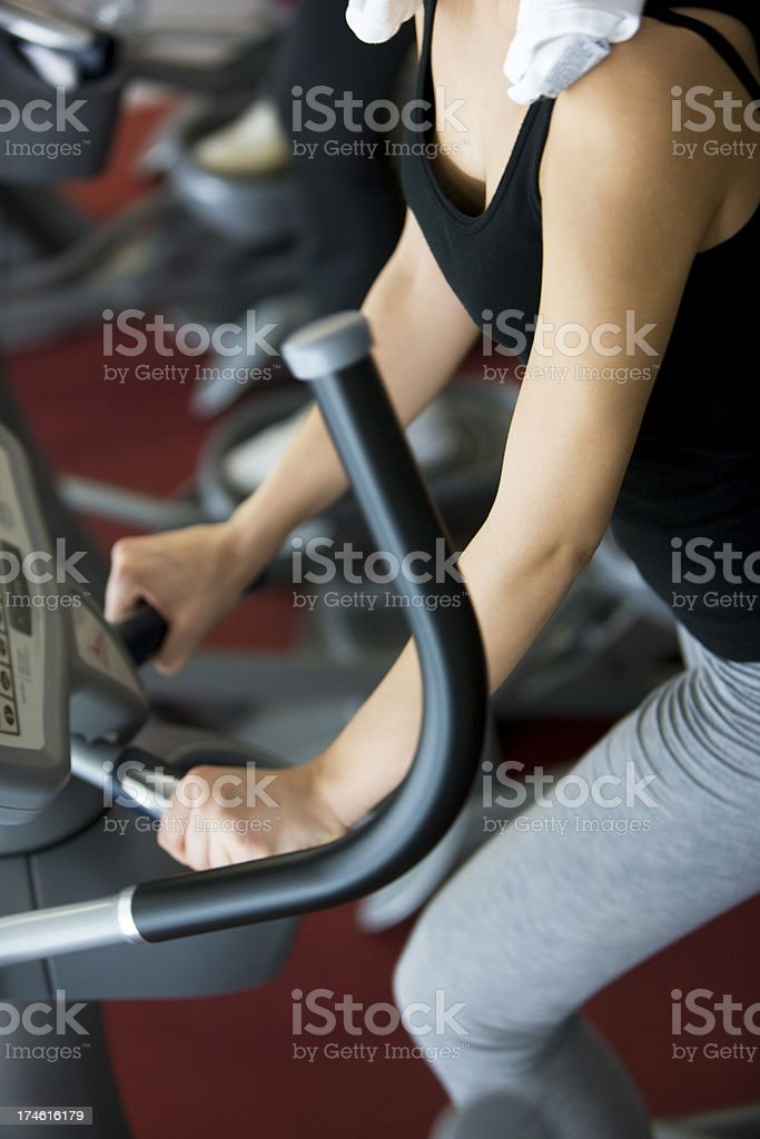 Woman on treadmill royalty-free stock photo