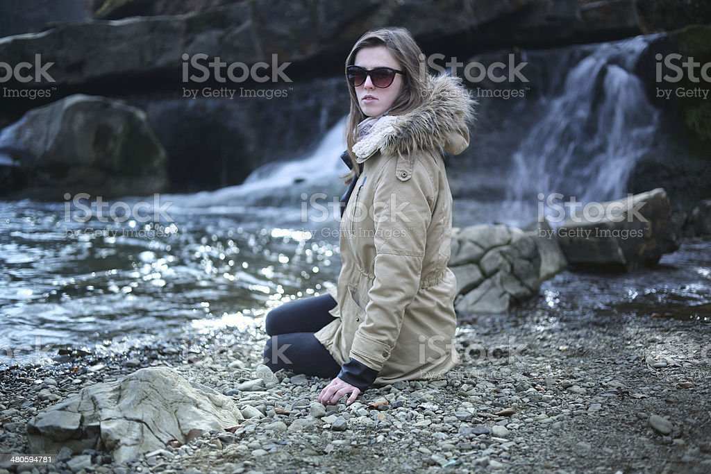 Woman on waterfall background royalty-free stock photo