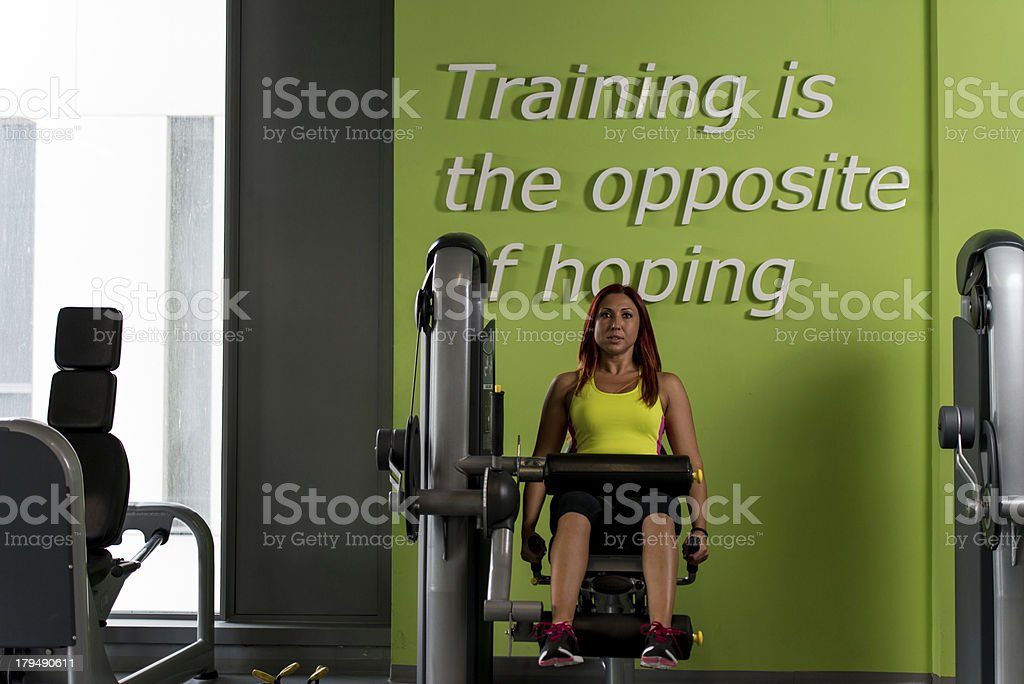 Woman on Weightlifting Machine royalty-free stock photo