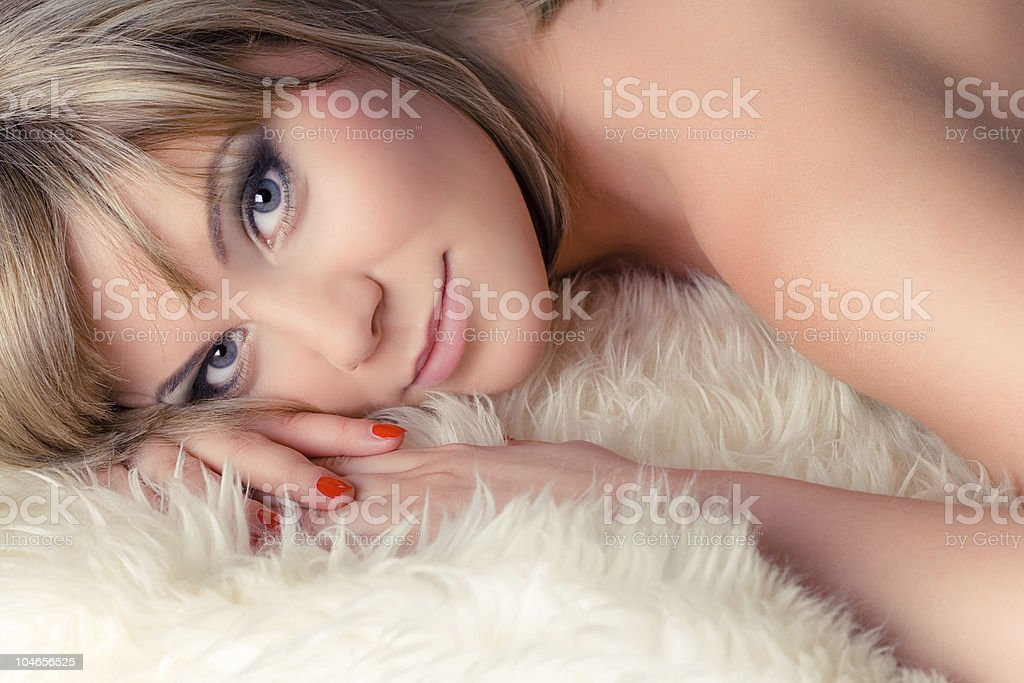 woman on white fur royalty-free stock photo