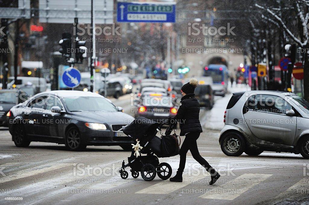 Woman on winter zebra crossing royalty-free stock photo