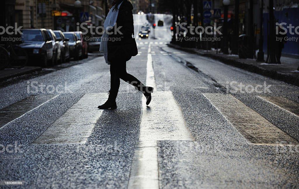 Woman on zebra crossing stock photo