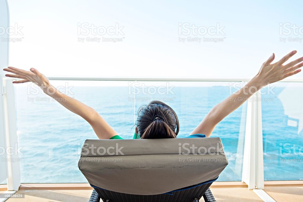Woman open arms on cruise stock photo