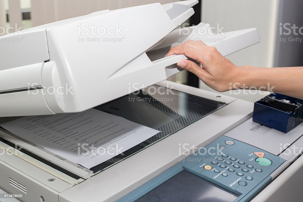 woman opening a photocopier stock photo