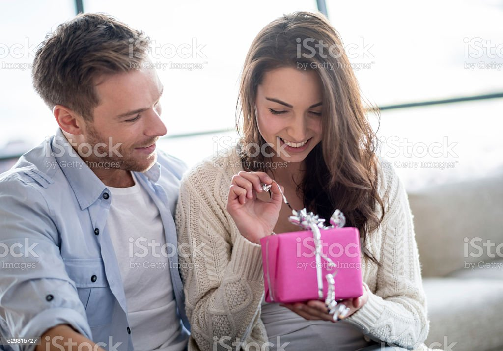 Woman opening a present stock photo