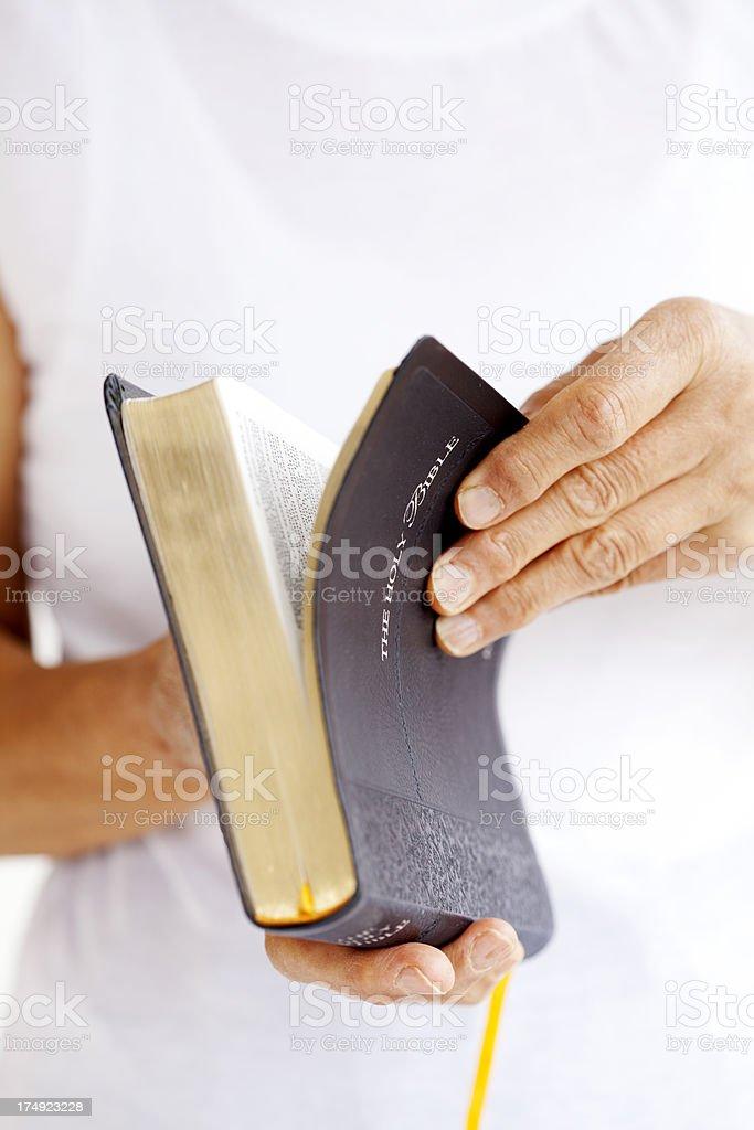 woman opening Bible stock photo