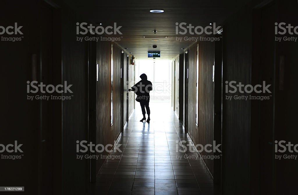 Woman opening door royalty-free stock photo