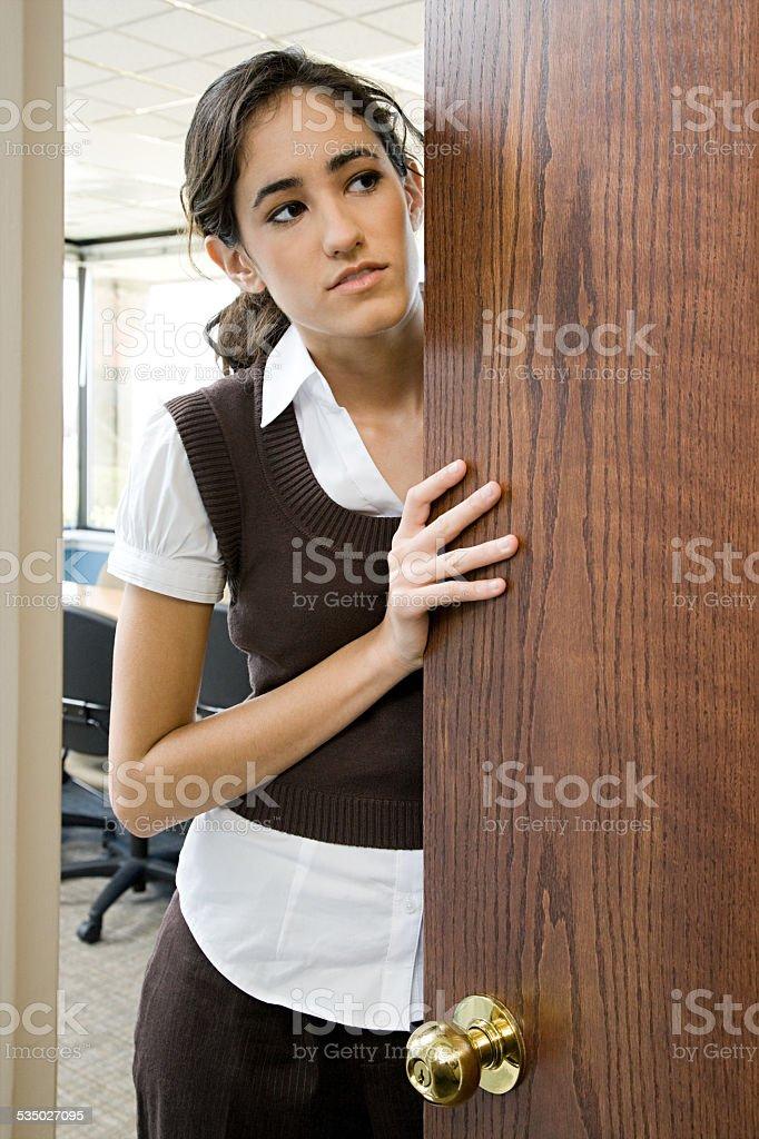 Woman opening door stock photo