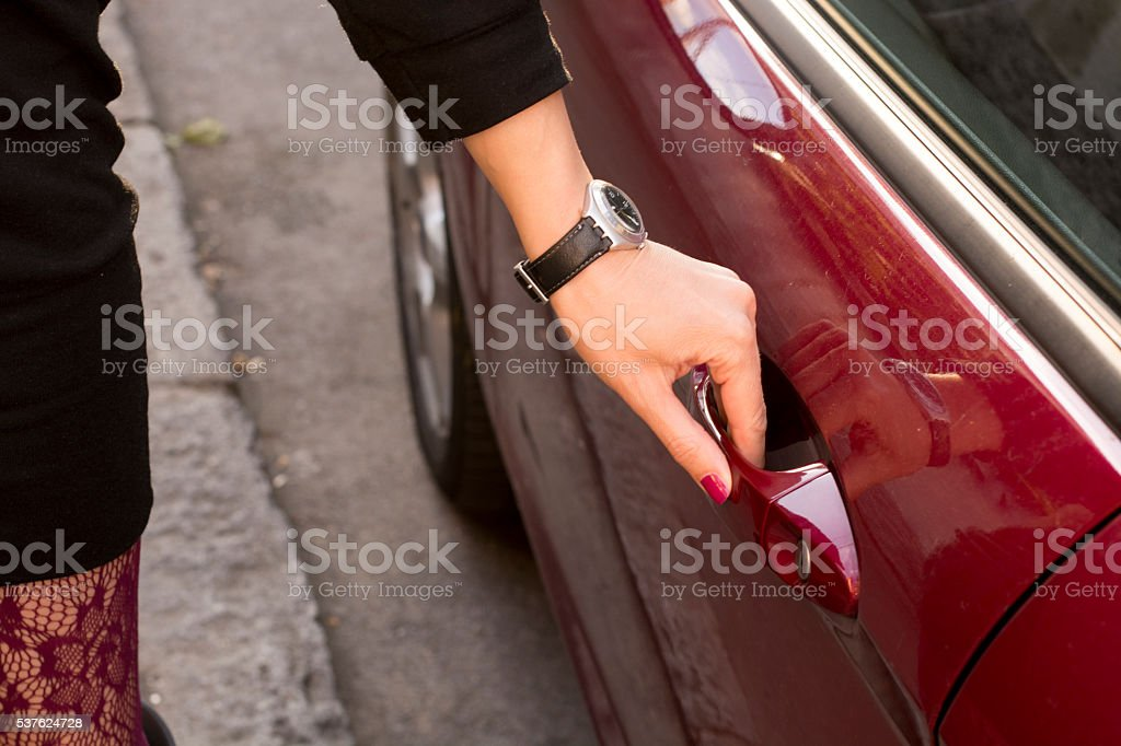 Woman opening her car stock photo
