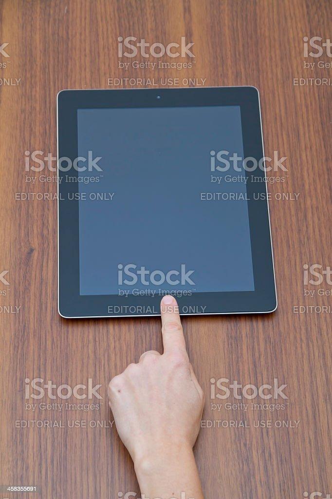 Woman opening iPad screen royalty-free stock photo