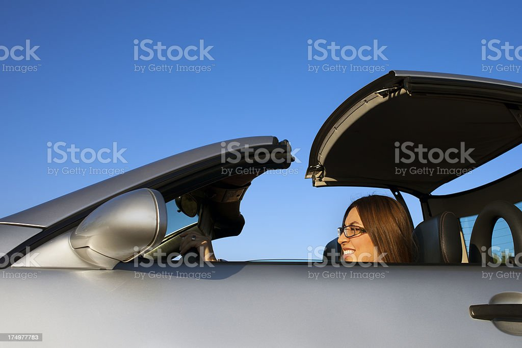 Woman opening the car's top side royalty-free stock photo