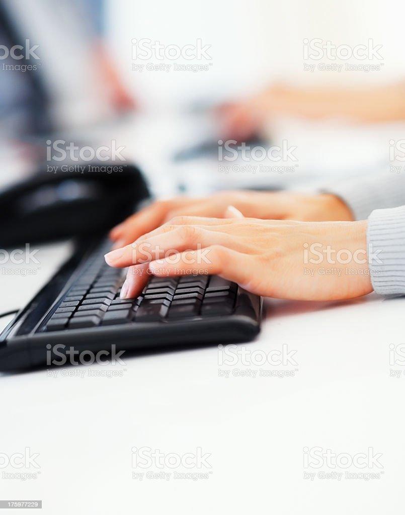 Woman operating computer stock photo