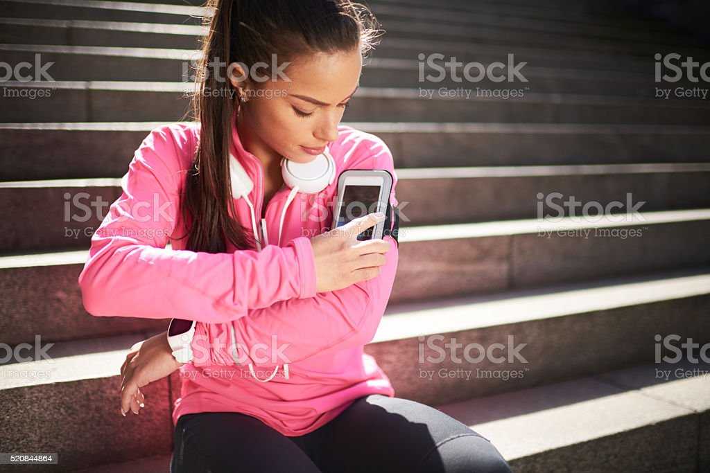 Woman operating on mobile smart phone stock photo