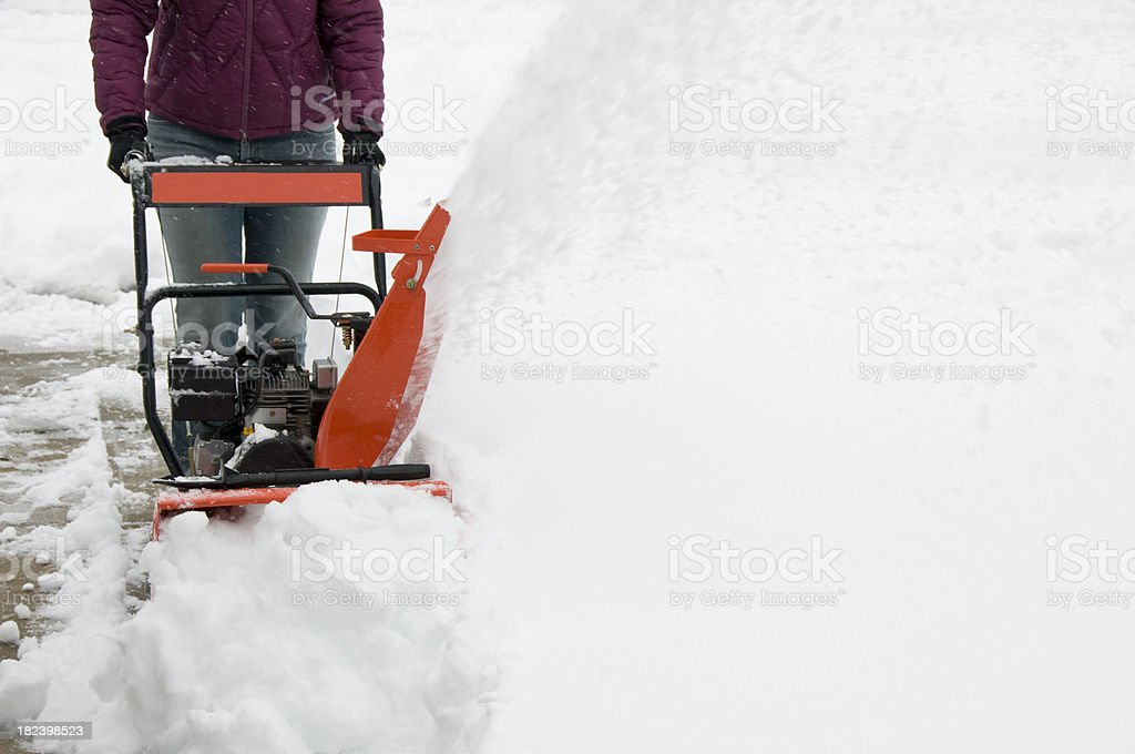 Woman Operating Snowblower stock photo