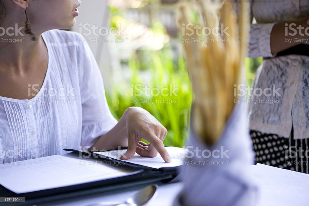 Woman ordering at cafe stock photo