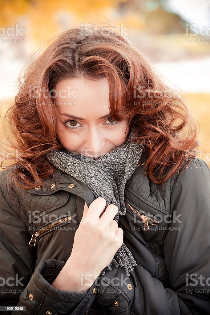 Woman out walking in the autumn sun stock photo