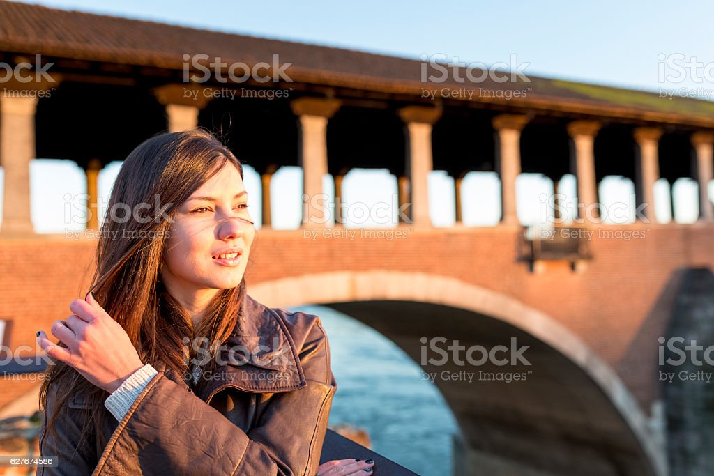 Woman outdoors at sunset stock photo