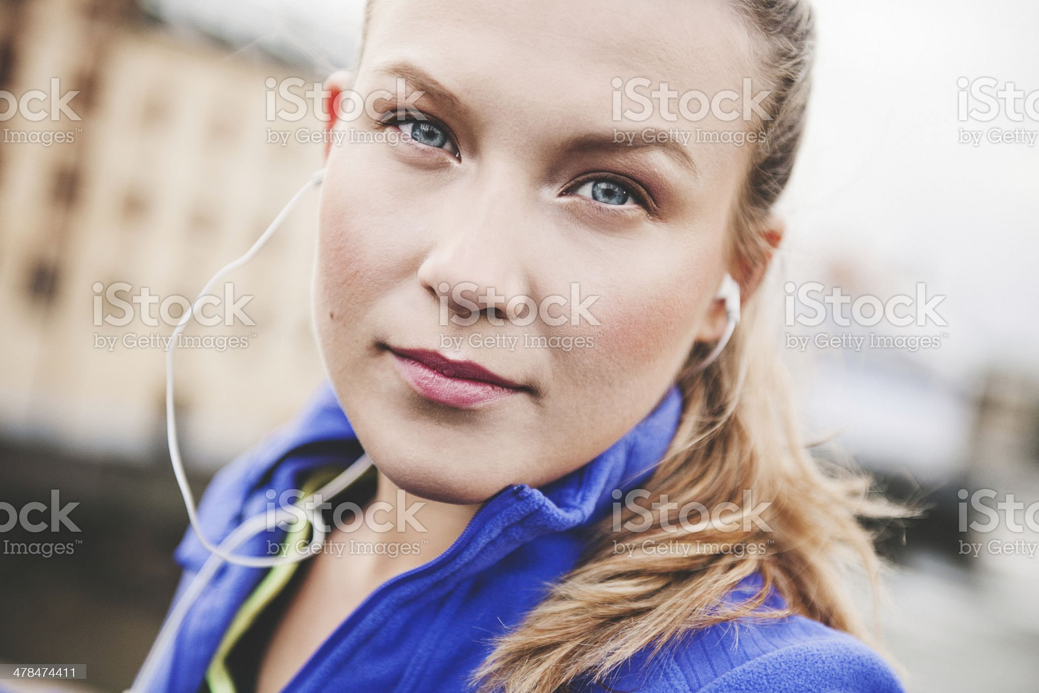 Woman outdoors listening to music in earbuds royalty-free stock photo