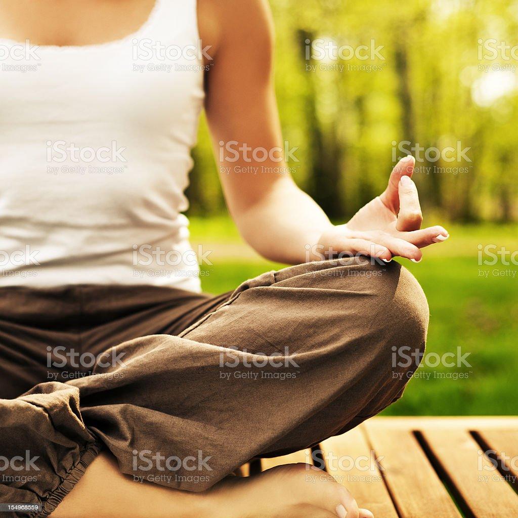 woman outdoors meditating royalty-free stock photo