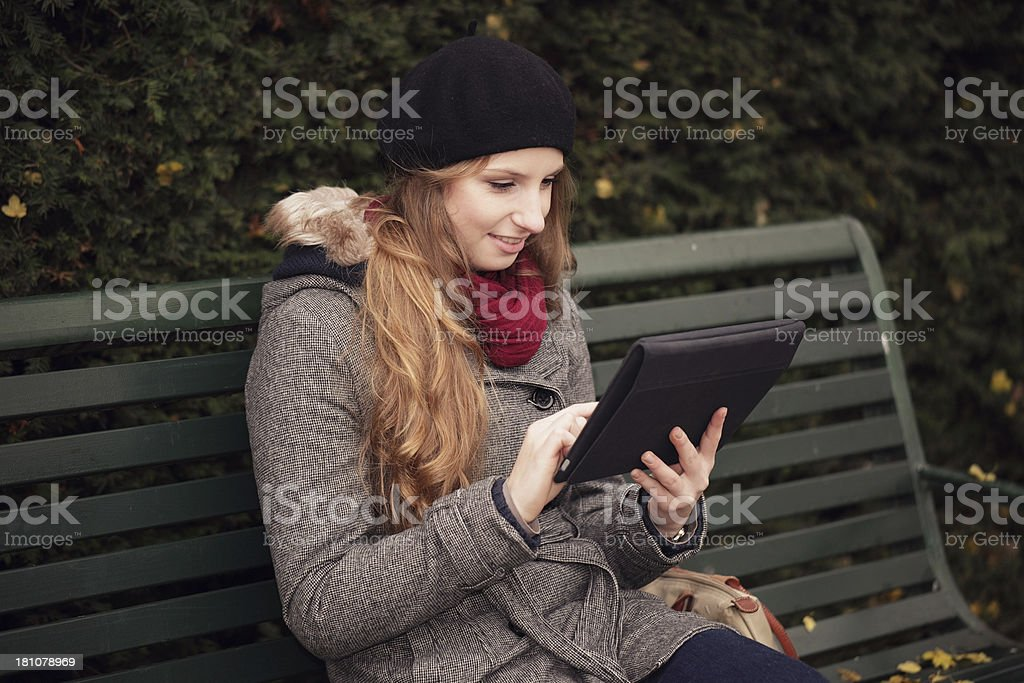 Woman outdoors using electronic tablet royalty-free stock photo