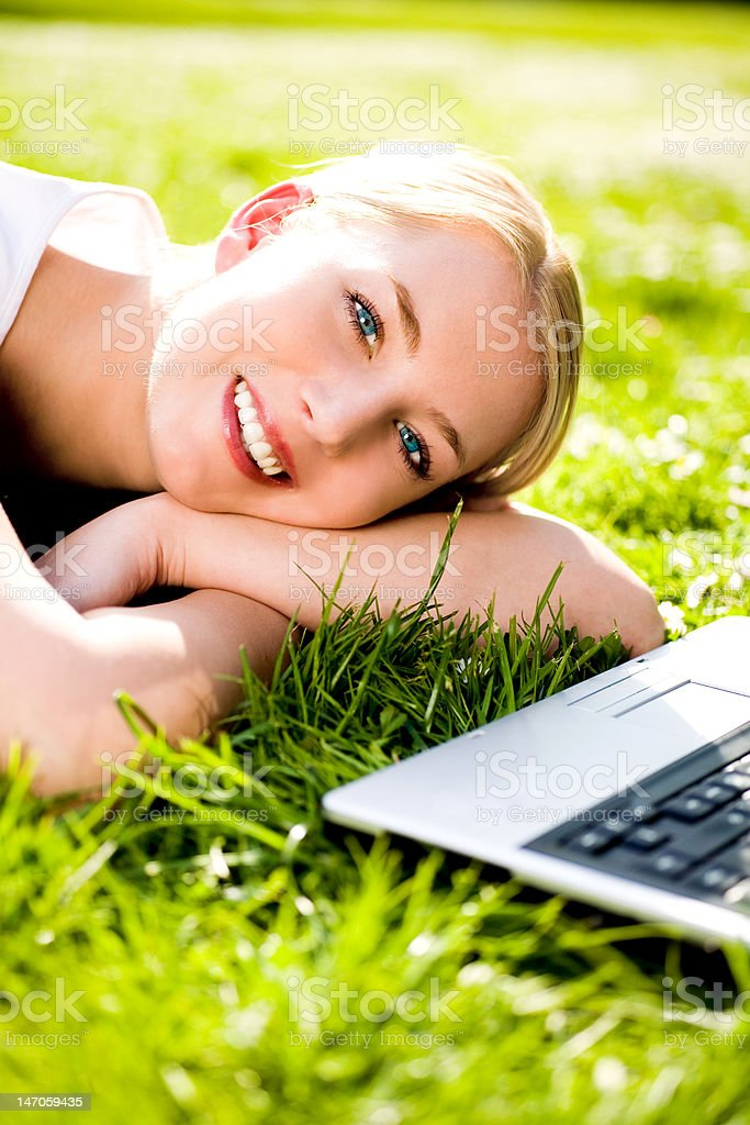 Woman outdoors with laptop royalty-free stock photo