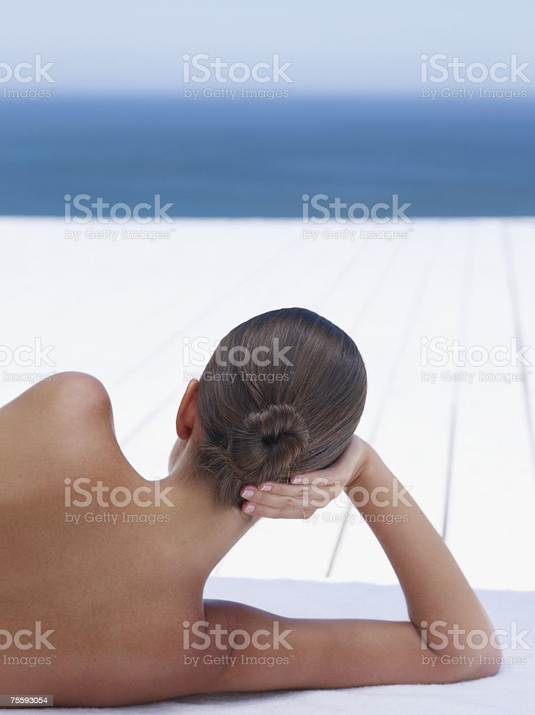 Woman outdoors with ocean backdrop stock photo