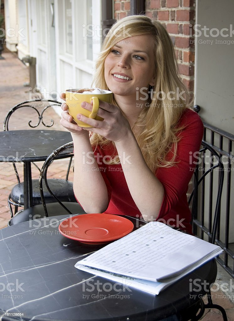 Woman outside a cafe royalty-free stock photo