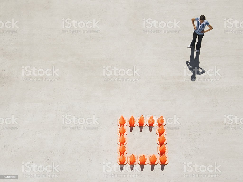Woman outside box of traffic cones royalty-free stock photo