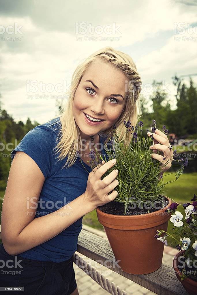 Woman outside on her deck stock photo