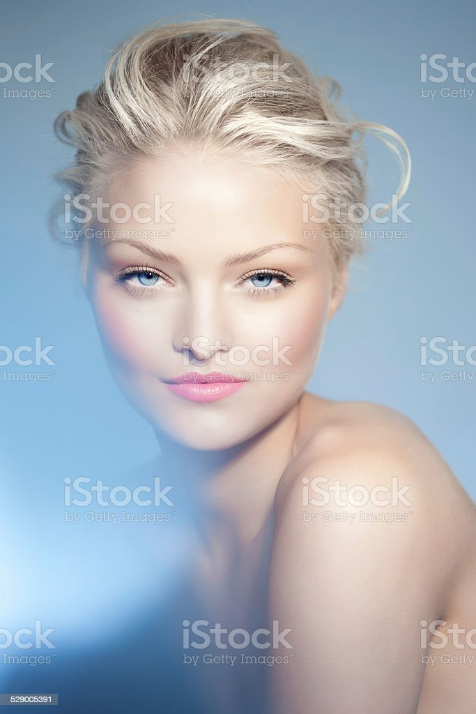 Woman Over Blue stock photo