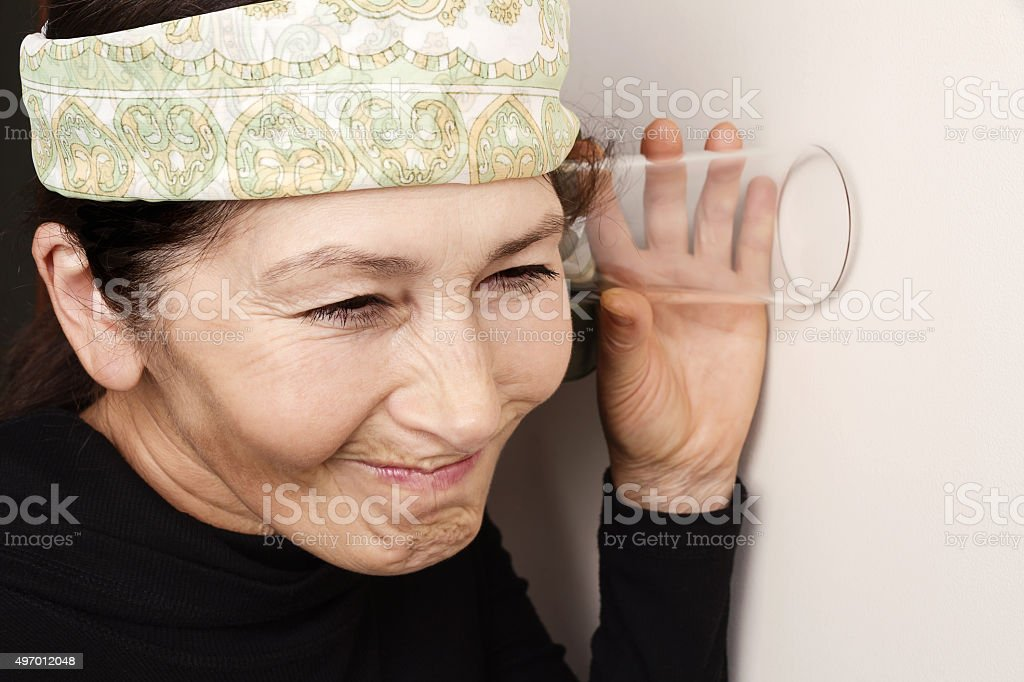 Woman overhears stock photo