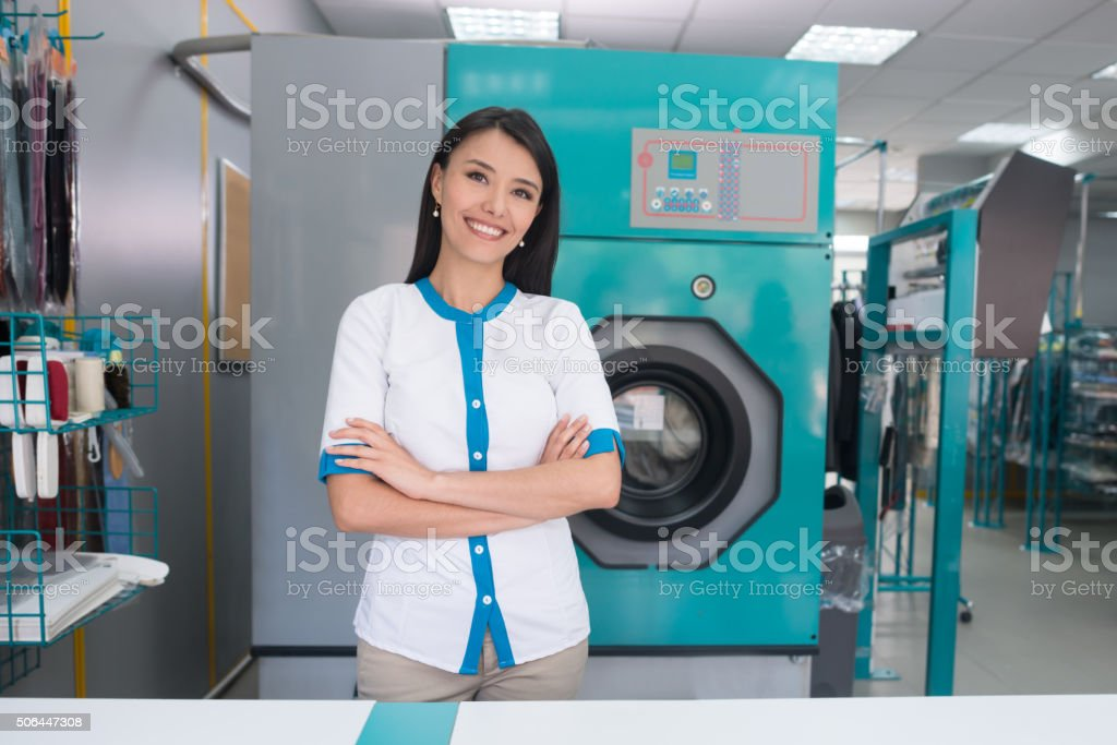 Woman owning a laundry service shop stock photo