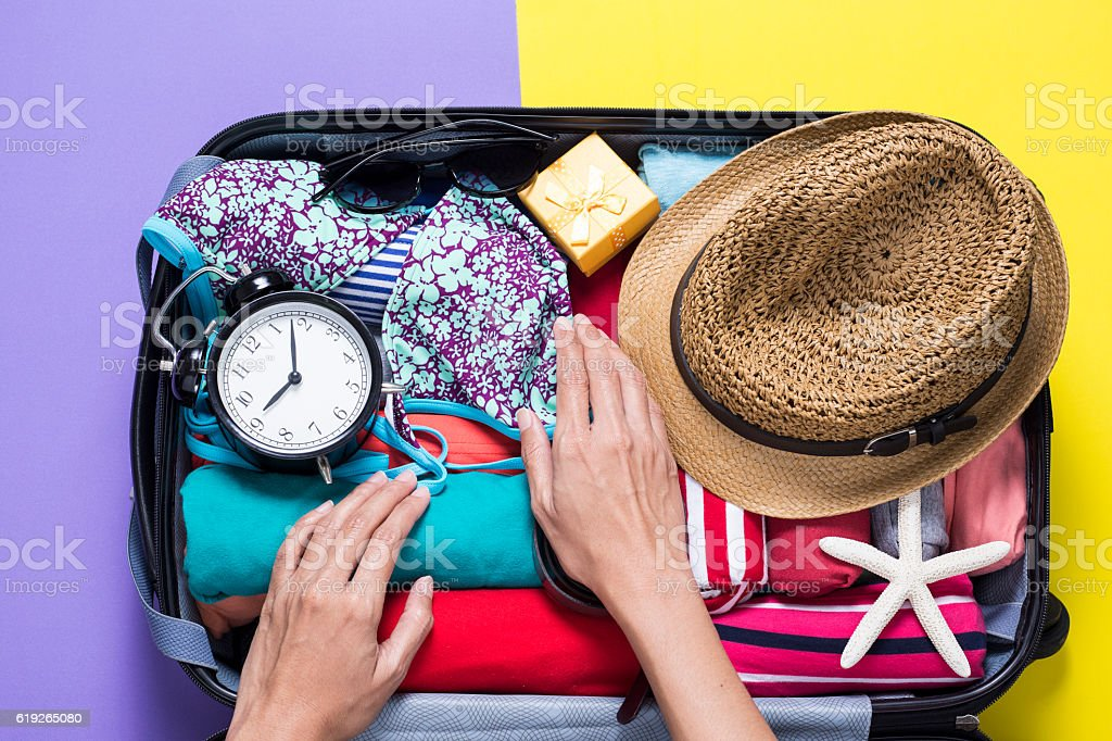 woman packing a luggage for a new journey stock photo