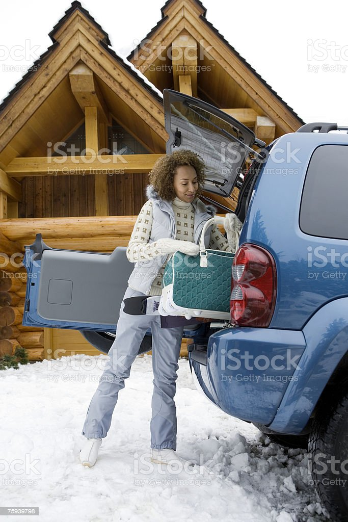 Woman packing car boot royalty-free stock photo