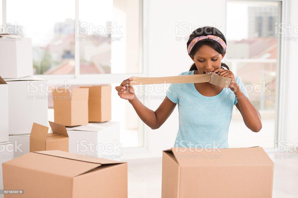 Woman packing carton boxes. stock photo