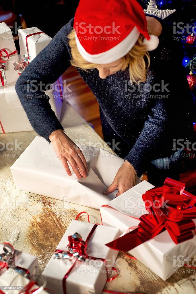 Woman Packing Christmas Boxes stock photo