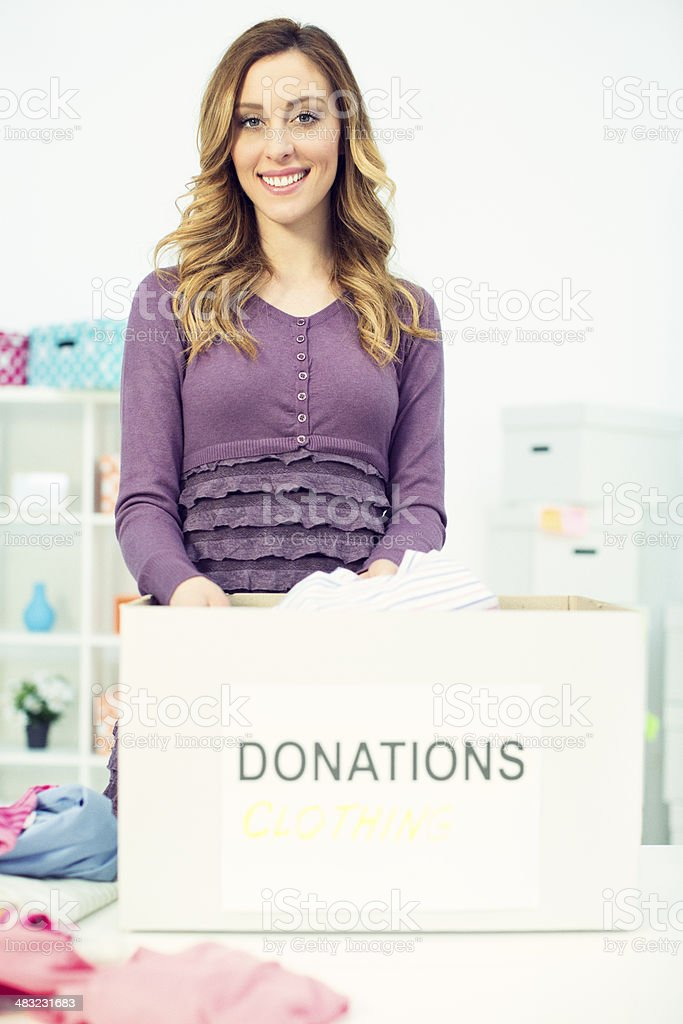 Woman packing clothes for donation. royalty-free stock photo