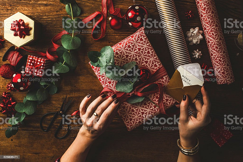 Woman packing contemporary christmas gifts stock photo