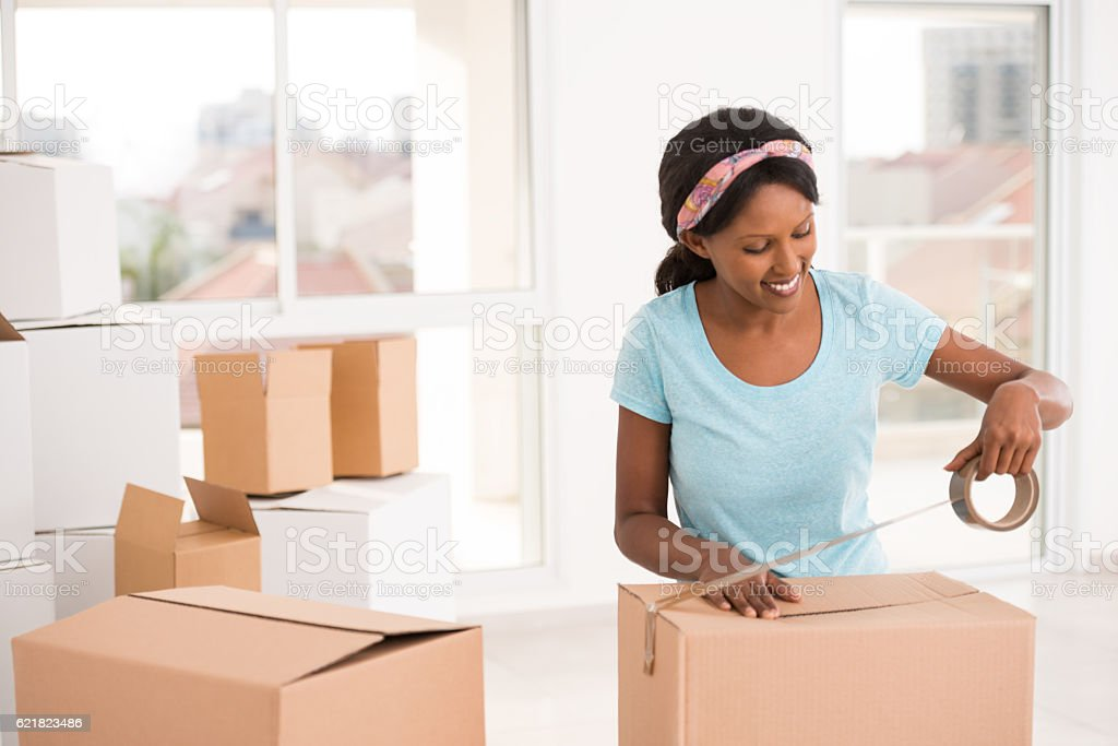 Woman packing for moving house. stock photo