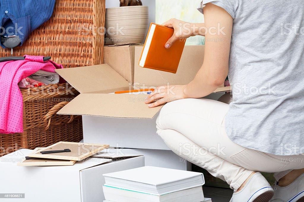 Woman packing house stuff stock photo