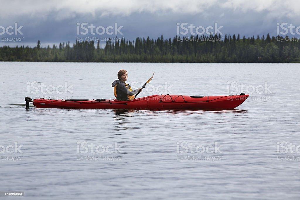 Woman paddling kayak royalty-free stock photo