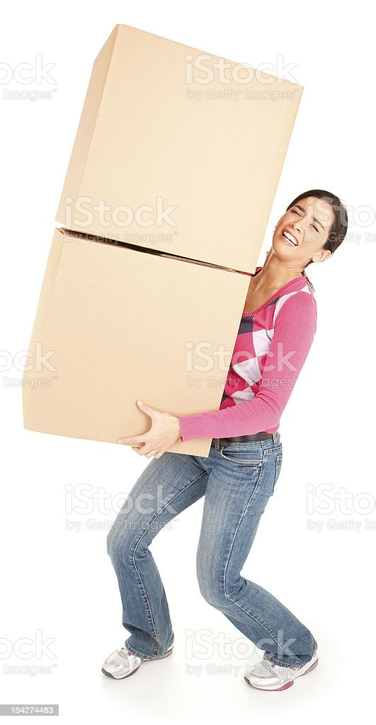 Woman Painfully Carrying Boxes stock photo